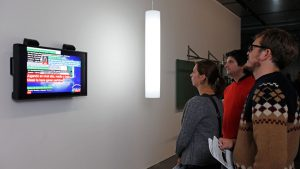 People watching TV Bot in a TV Flatscreen at ZKM Karlsruhe